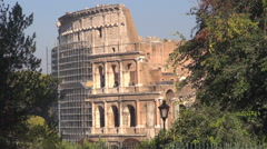 Great Colosseum forum Rome landmark old arena reconstruction restoration sunny  Stock Footage
