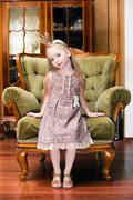 little princess on a chair - stock photo