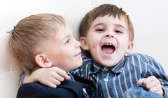Two brothers play Stock Photos