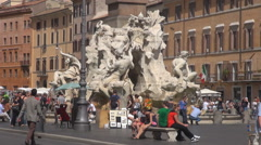 Tourist people visit Navona Square Rome downtown Neptune Fountain sunny day icon Stock Footage