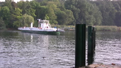 Ferry approaching Pfaueninsel on the river Havel in Germany Stock Footage