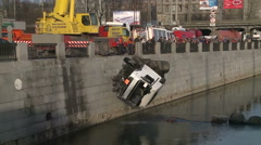Service Emergency Situations Ministry raises broken car from the city canal. Stock Footage