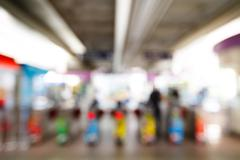 abstract blurred people using automatic ticket gates - stock photo
