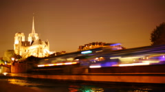 Cruise boats pass Notre Dame at night TL 4K Stock Footage
