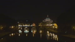 Zoom in St Peters cathedral church dome Vatican Rome landmark night water iconic Stock Footage