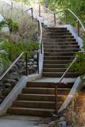 curving concrete stairway at outdoor public park - stock photo