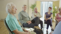 Mature people in group therapy session talk about their problems together Stock Footage