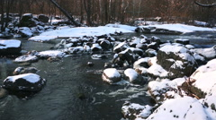 Stones covered with snow in the river in winter Stock Footage
