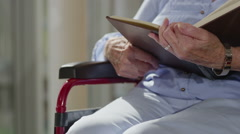 Close up caring nurse holding hand of elderly female patient in a wheelchair - stock footage