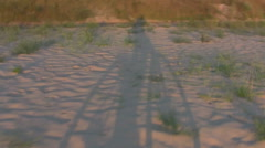 Man on Bicycle silhouettes on sand - stock footage