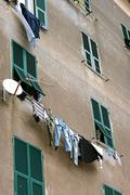 Linen sohnat on the facade of a large old house in Italy Stock Photos