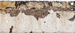 large crack in the concrete beam - stock photo