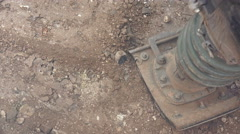 Uhd power hand compactor working on construction site, top view, close up. so Stock Footage