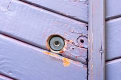 Wall with blue paint and keyhole Stock Photos