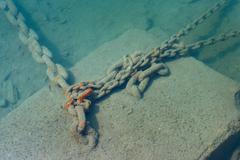 anchor chain underwater in the sea - stock photo