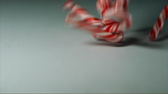 Christmas Candy Cane dropping into shot slow motion Stock Footage