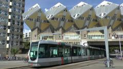 Tram runs under the Cube houses designed by Piet Blom, Rotterdam, Netherlands. Stock Footage