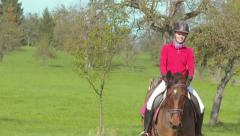 Girl Riding Meadow Slow Motion Stock Footage