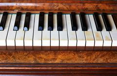 Piano keys of an old German piano - stock photo