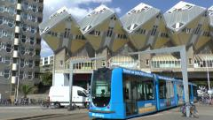 Tram passing under Cube houses designed by Piet Blom, Rotterdam, Netherlands. Stock Footage