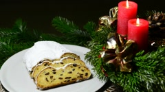 German Christmas bakery Stollen with Advent wreath - stock footage