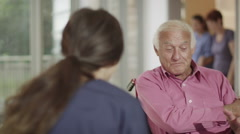 Caring nurse giving support to elderly male patient and his wife Stock Footage