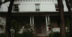 Dolly shot of house, White, Driving, Mid-Century Stock Footage