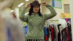 Girl Measures The Cowboy Hat In The Store - stock footage