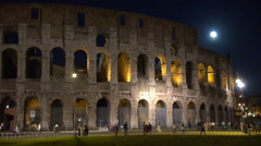 Timelapse tourist people visit Great Colosseum forum Rome night moon light ruin Stock Footage
