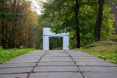 Arc passage in the forest - stock photo