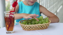 Girl outdoors. Child playing in the Kids Count and then eats grapes Stock Footage