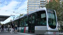 Electric RET tram pulling in to a stop in Rotterdam, Netherlands. Stock Footage