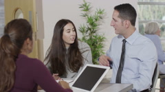 Young couple in meeting with financial advisor - stock footage