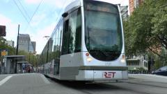Low level view of a tram pulling away from a tram stop, Rotterdam, Netherlands. Stock Footage