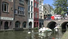 Stock Video Footage of Paddle boat and cruise boat on a canal in Utrecht, Netherlands.