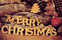 wooden letters forming the sentence merry christmas - stock photo