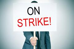 Stock Photo of young man in suit on strike