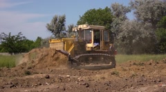 Excavator during the preparation of a construction site Stock Footage