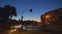 Timelapse Great Colosseum forum traffic street freeway twilight Rome city iconic Stock Footage
