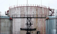 Industrial storage tanks with a latter access Stock Photos