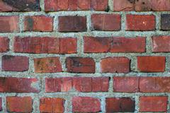 old weathered stained red brick wall - stock photo