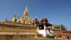 Buddhist Monks at Pha That Luang Stupa in Vientiane, Laos Stock Footage