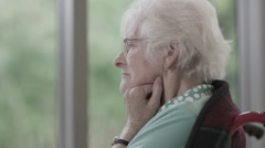 Portrait of lonely senior lady alone with her thoughts - stock footage