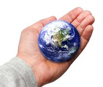 Planet earth in the human hand. isolated on white background Stock Photos