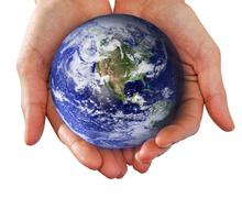 Human hand holding the world in her hands Stock Photos