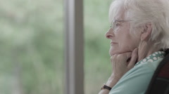 Portrait of lonely senior lady alone with her thoughts  Stock Footage