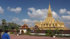 Visitors at Pha That Luang Stupa in Vientiane, Laos Stock Footage