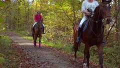 2 Riding Girls In Forest Slow Motion Automn Stock Footage