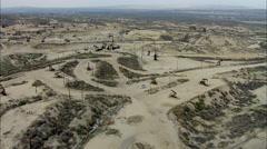 Oil Rigs Dirt Roads Hills Stock Footage