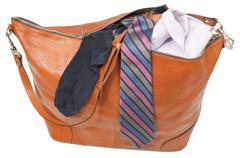 leather handbag with shirt, tie, sock isolated - stock photo